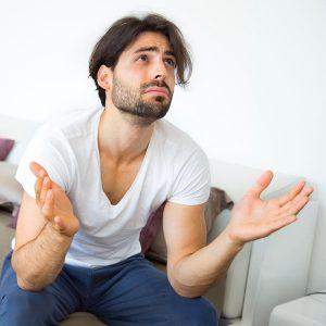 Worried man having difficulties in bedroom.