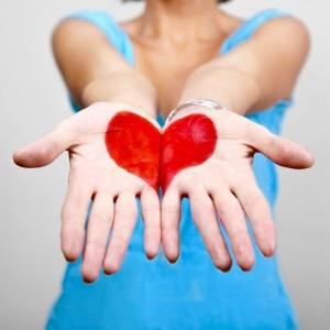 red heart on the palms of a woman