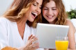 Mother and daughter on digital tablet