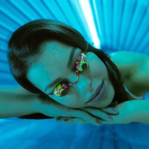 Woman in bed solarium