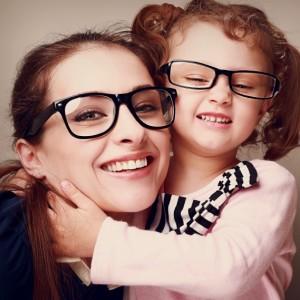 Loving happy mother and smiling daughter hugging. Vintage closeup portrait